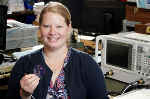 Pike holding an experimental antenna she tested as part of her research experience in the lab of CNT member, Matt Reynolds. The antenna is designed to transmit power and data to an implantable wireless communication chip. This research is aimed at reducing the need for invasive surgeries to replace batteries in neural devices and other medical implants, such as pacemakers.