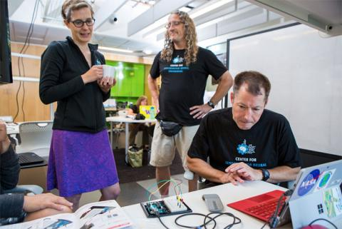 CNT Engineering Education Research Manager, Kristen Bergsman, talks with Bencivengo (center), while RET participant, Adam King (right), concentrates on the artificial neural network curriculum Bencivengo shared with him during this 2017 RET workshop.