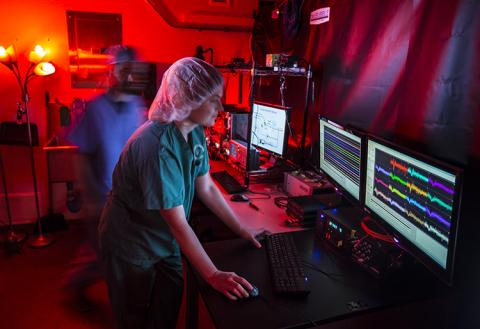 A women working with neuroscience equipment