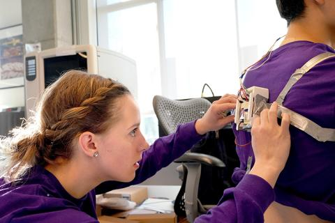 Karley Benoff, Hackathon participant and UW graduate student in mechanical engineering, adjusts the prototype her team, Rehabilitation for Independent Seated Extension (RISE) designed.