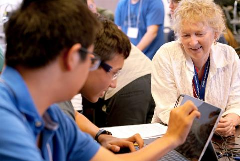 """CNT Precollege Education Manager, Janis Wignall assists students in the 2018 YSP-REACH program. Wignall said of Pang, """"She became a valuable source of knowledge within the YSP-REACH program, teaching curriculum she developed at the CNT about constructing sensory substitution devices using Arduino microprocessors and coaching students to have a successful experience."""""""