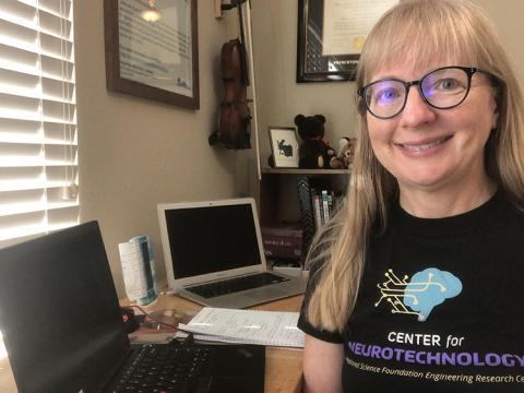 Karen Allendoefer at her desk