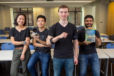 Members of Team Os(eye)ris, including Armin Rouz (far right), with their engineering prototype.