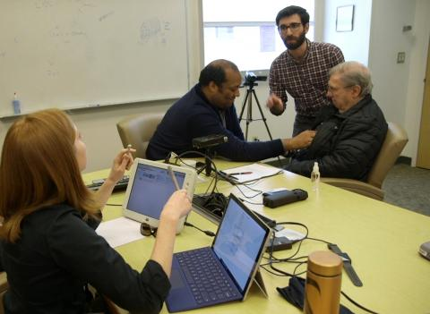 The CNT research team working with a patient