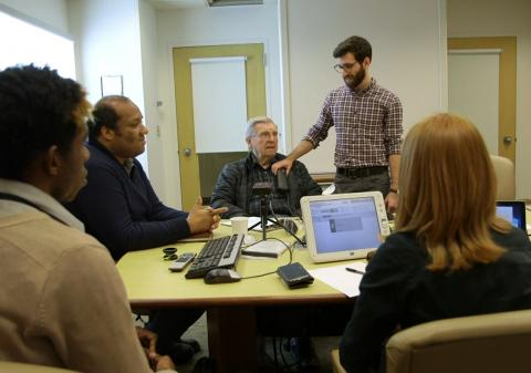 The CNT research team calibrating a patient's DBS device