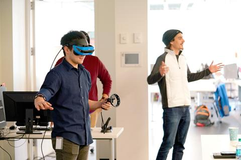 Jackson Chin, Tomek Faczek and Amir Gull, members of Team VR-tusoso Phantastic, demonstrate their virtual reality platform that allows people who have amputation below the elbow to see their missing limb and practice exercises that relieve phantom limb pain.