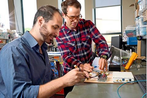 CNT student members, James Rosenthal and Lefteris Kampianakis, working in the lab of CNT member, Matt Reynolds