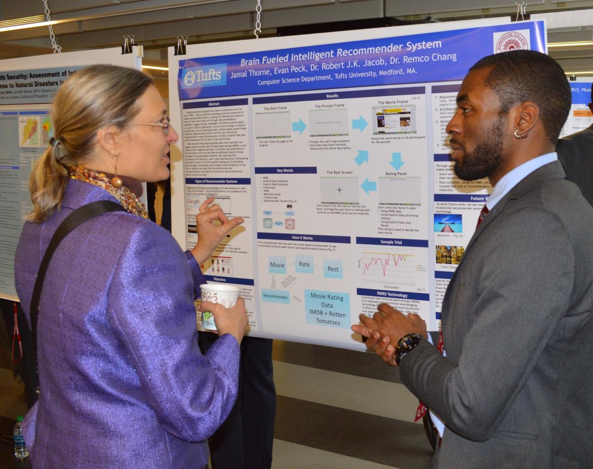 Jamal Thorne (right), Morehouse College '15 explains his research
