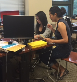 Larissa Ho (left) works with Nile Wilson, PhD student at UW