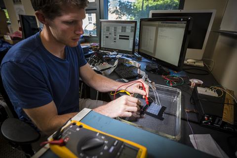 CNT student member, David Caldwell, working on an electrocorticographic (ECoG) grid in the lab
