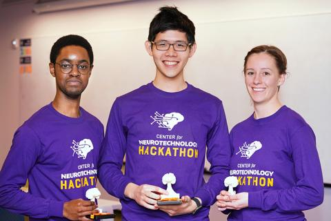 2019 CNT Hackathon winners, Team RISE, pose with their trophies in-hand.