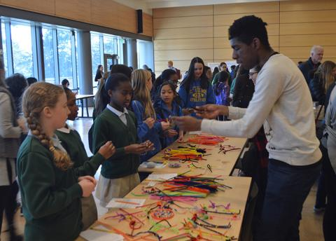 Students could take part in a wide variety of interactive exhibits, including this one, which focused on building neuron models out of colorful pipe cleaners.