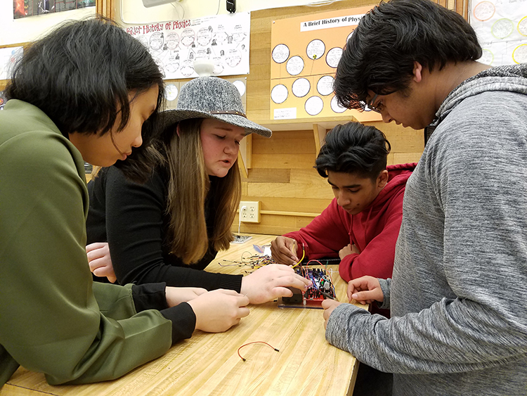 Students at Juanita High School working on circuitry unit