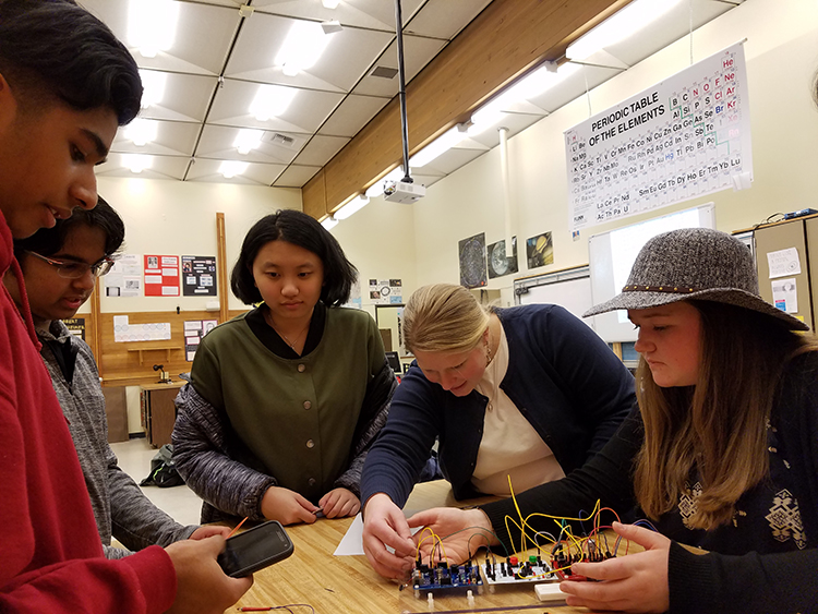 Alexandra Pike and students at Juanita High School working on circuitry unit