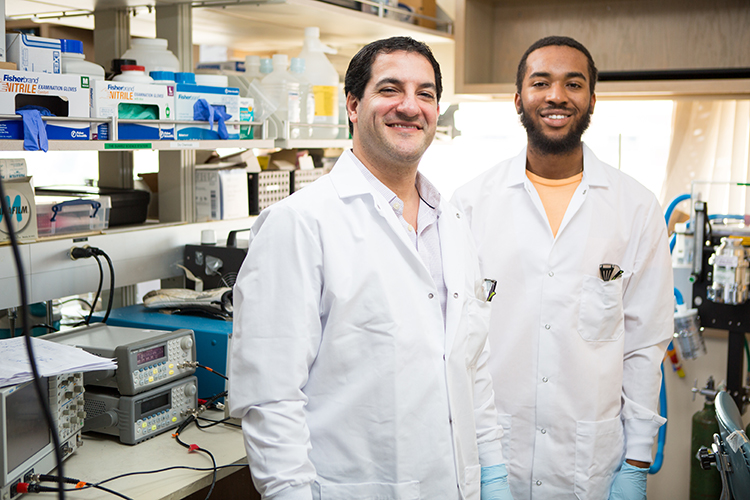 Jesse Woodbury and Dr. Saigal in the lab at UW Medicine