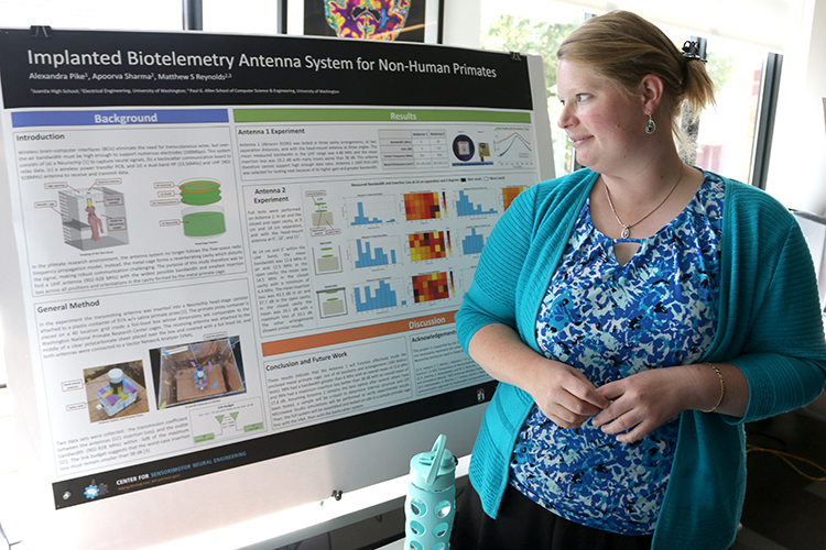 Alexandra Pike, with her research project poster at the CSNE