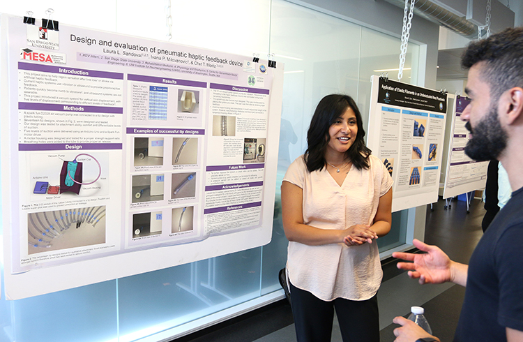 REV participant, Laura Sandoval, with her research project poster in the CSNE