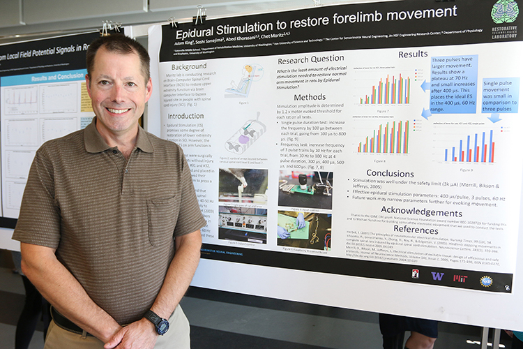 RET participant, Adam King, with his research poster at the CSNE
