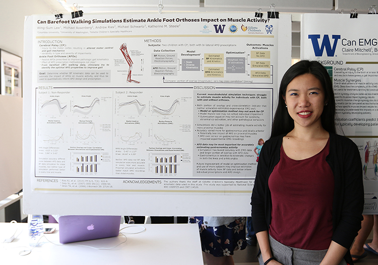 Wing-Sum Law showing her research project poster