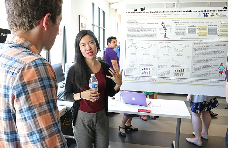 REU participant, Wing-Sum Law, answering questions about her research project poster (shown)